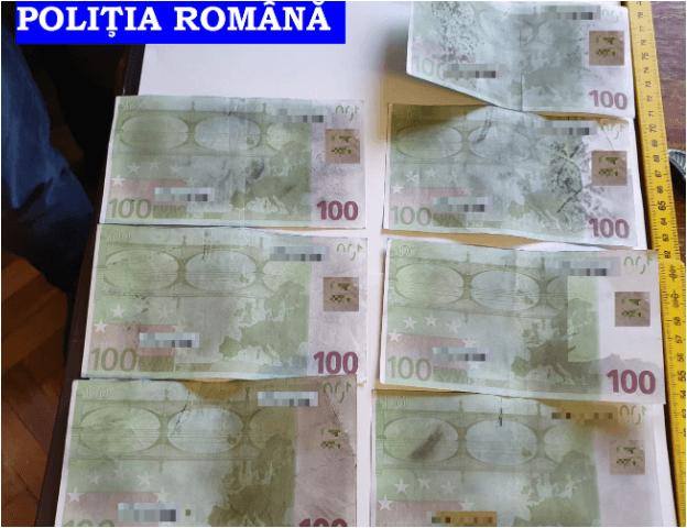 Escrocherie cu bani falși. Autorii prinși în flagrant delict